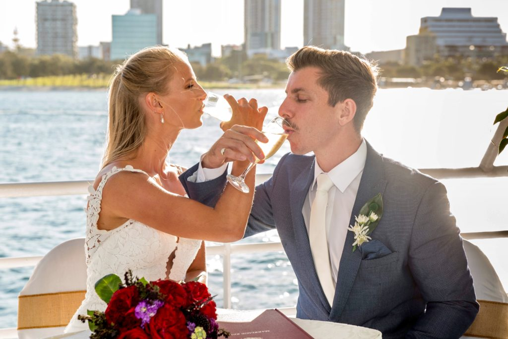 gold coast cruises pop-up wedding glass of bubbles